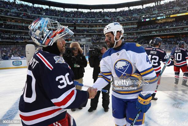 Goaltender Henrik Lundqvist of the New York Rangers and Zach Bogosian of the Buffalo Sabres shake hands after the 2018 Bridgestone NHL Winter Classic...