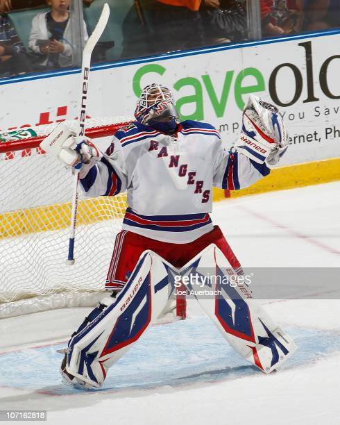 Goaltender Henrik Lundqvist of the New York Rangers celebrates the 30 shutout of the Florida Panthers on November 26 2010 at the BankAtlantic Center...
