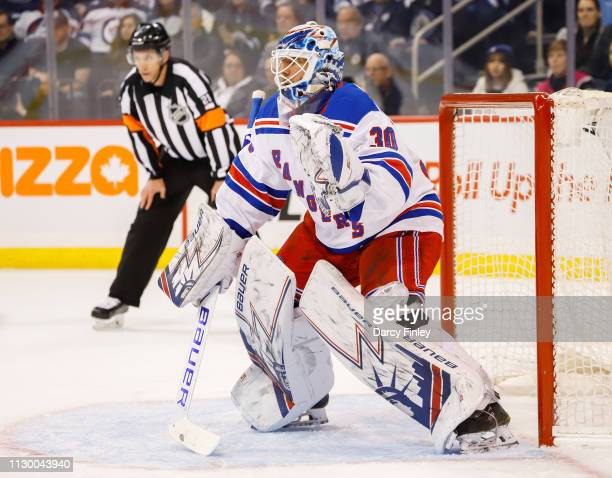 Goaltender Henrik Lundqvist of the New York Rangers guards the net during first period action against the Winnipeg Jets at the Bell MTS Place on...