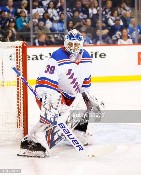 Goaltender Henrik Lundqvist of the New York Rangers guards the net during second period action against the Winnipeg Jets at the Bell MTS Place on...