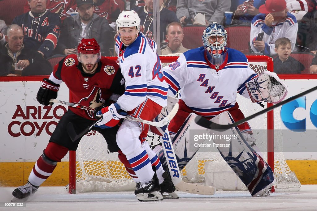 Goaltender Henrik Lundqvist #30 of the New York Rangers in net as Tobias Rieder #8 of the Arizona Coyotes battles with Brendan Smith #42 during the NHL game at Gila River Arena on January 6, 2018 in Glendale, Arizona. The Rangers defeated the Coyotes 2-1 in an overtime shootout.