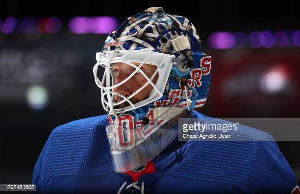 Goaltender Henrik Lundqvist of the New York Rangers looks on before playing in the exhibition game against the New York Islanders prior to the 2020...