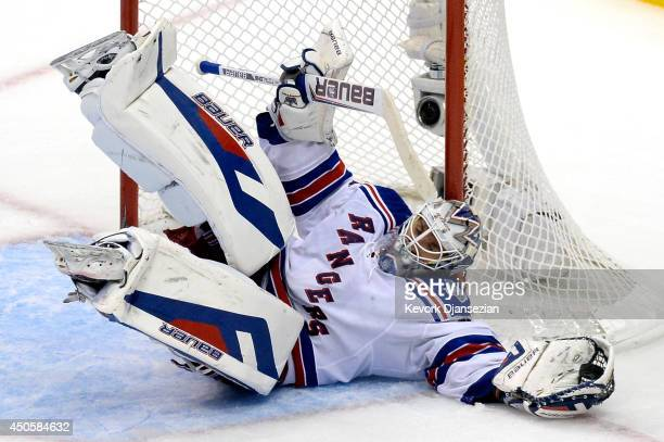 Goaltender Henrik Lundqvist of the New York Rangers makes a save in the third period against the Los Angeles Kings during Game Five of the 2014...