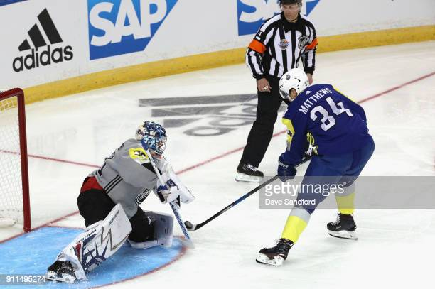 Goaltender Henrik Lundqvist of the New York Rangers makes a save on a backhand by Auston Matthews of the Toronto Maple Leafs during the 2018 Honda...