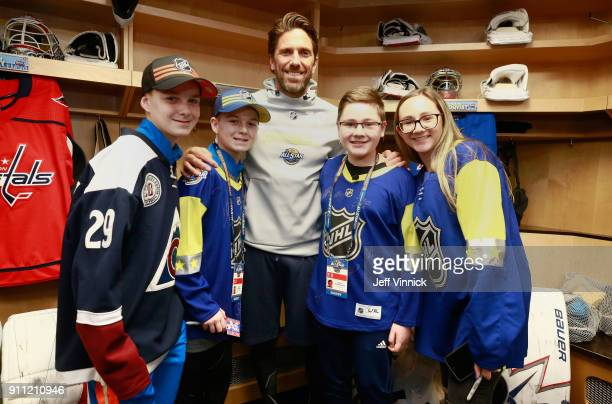 Goaltender Henrik Lundqvist of the New York Rangers poses with MakeAWish kids Steven Koutrouliotis and Felix Powers and their siblings in the locker...