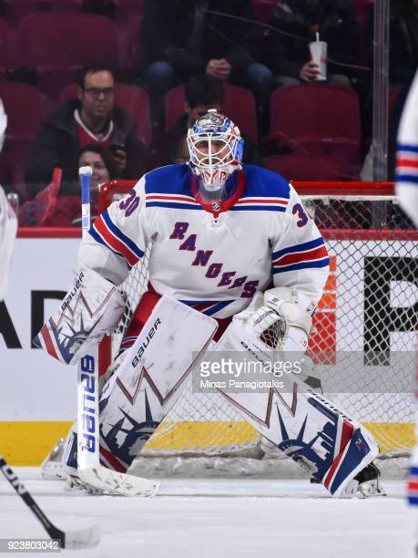 Goaltender Henrik Lundqvist of the New York Rangers protects his net during the warmup against the Montreal Canadiens prior to the NHL game at the...