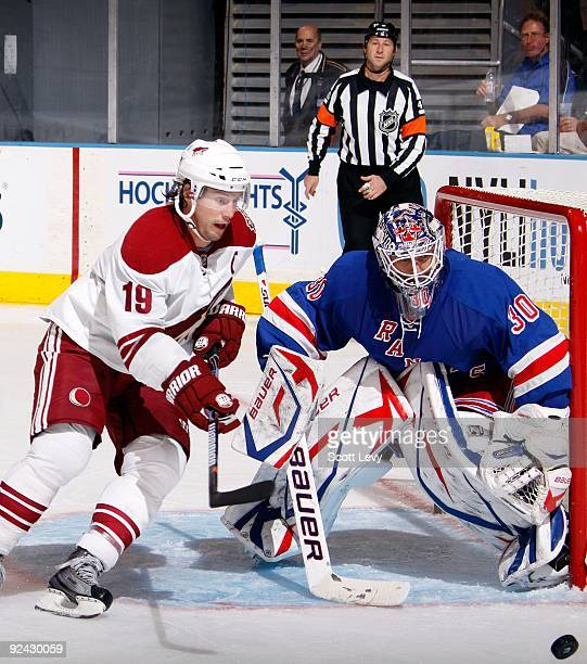 Goaltender Henrik Lundqvist of the New York Rangers protects the net against Shane Doan of the Phoenix Coyotes on October 26 2009 at Madison Square...