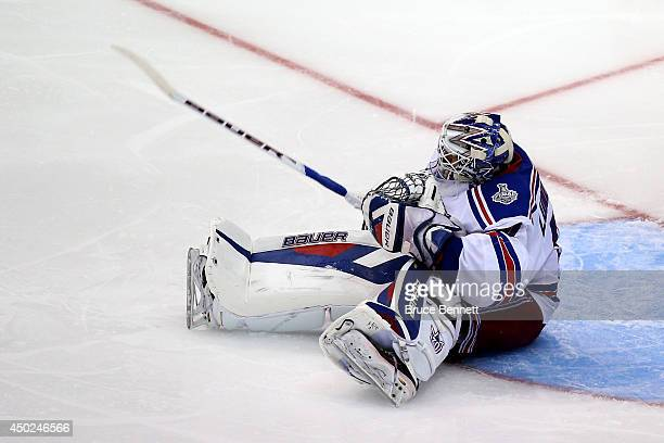Goaltender Henrik Lundqvist of the New York Rangers reacts in the third period while taking on the Los Angeles Kings during Game Two of the 2014 NHL...