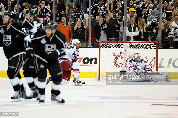 Goaltender Henrik Lundqvist of the New York Rangers sits in the net after Dustin Brown of the Los Angeles Kings celebrates his double overtime game...