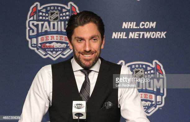 Goaltender Henrik Lundqvist of the New York Rangers speaks at a postgame press conference after the 2014 Coors Light NHL Stadium Series at Yankee...