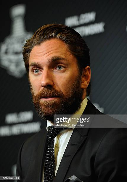 Goaltender Henrik Lundqvist of the New York Rangers speaks to the media following his team's 21 victory over the Los Angeles Kings in Game Four of...