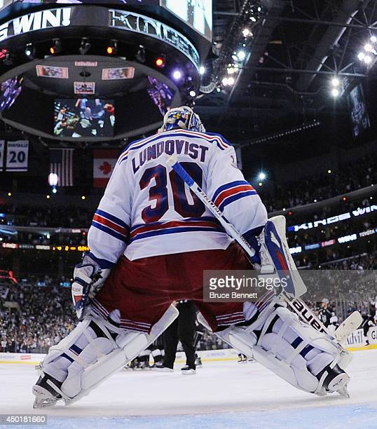 Goaltender Henrik Lundqvist of the New York Rangers stands in the net after Justin Williams of the Los Angeles Kings scores the game-winning goal as...