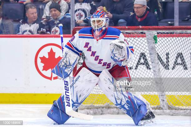 Goaltender Henrik Lundqvist of the New York Rangers takes part in the pre-game warm up prior to NHL action against the Winnipeg Jets at the Bell MTS...