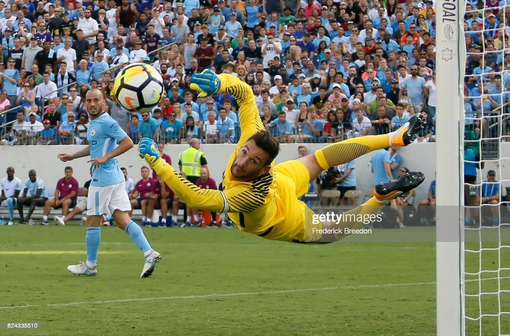 Goaltender Hugo Lloris #1 of Tottenham dives to make a save against Manchester City during the first half of the 2017 International Champions Cup Presented by Heineken at Nissan Stadium on July 29, 2017 in Nashville, Tennessee.