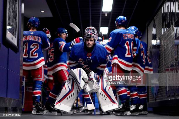 Goaltender Igor Shesterkin of the New York Rangers prepares to play in the third period of the exhibition game against the New York Islanders prior...