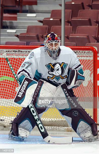 Goaltender Ilja Bryzgalov of the Anaheim Mighty Ducks crouches in goal before the preseason NHL game against the Los Angeles Kings at the Arrowhead...