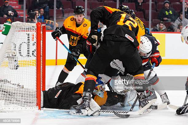 Goaltender Ilja Sharipov of Team Germany falls to the ice looking for the puck with traffic in front of him during the 2015 IIHF World Junior Hockey...