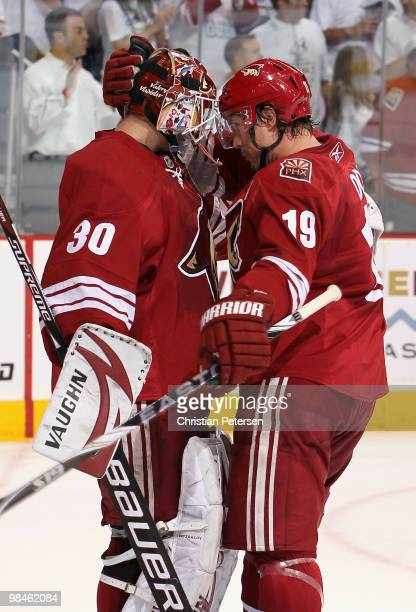 Goaltender Ilya Bryzgalov and Shane Doan of the Phoenix Coyotes celebrate after defeating the Detroit Red Wings in Game One of the Western Conference...