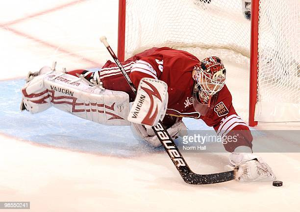 Goaltender Ilya Bryzgalov of the Phoenix Coyotes dives to cover up the puck against the Detroit Red Wings in Game Two of the Western Conference...