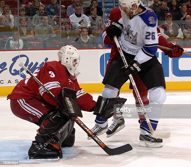 Goaltender Ilya Bryzgalov of the Phoenix Coyotes makes a save in front of Michal Handzus of the Los Angeles Kings on November 21 2007 at Jobingcom...