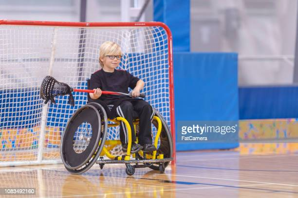 goaltender in a wheelchair - fat goalkeeper stock pictures, royalty-free photos & images