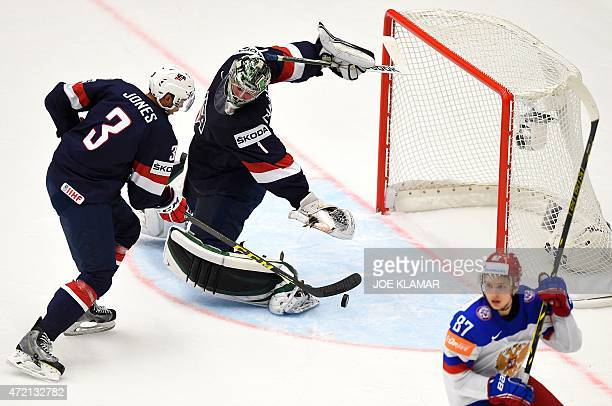 Goaltender Jack Campbell and his teammate Seth Jones are watching a puck during the group B preliminary round ice hockey match Russia vs USA of the...