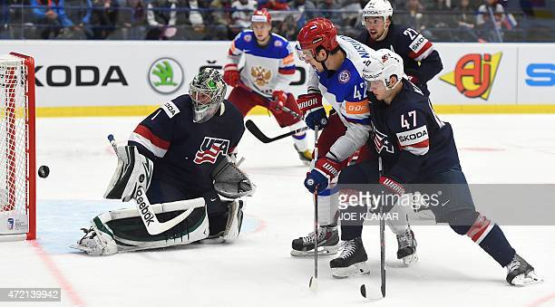 Goaltender Jack Campbell eyes a puck shot by Russia's Artyom Anisimov during the group B preliminary round ice hockey match Russia vs USA of the IIHF...