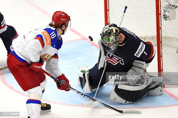 Goaltender Jack Campbell makes a save from Russia's Sergei Plotnikov during the group B preliminary round ice hockey match Russia vs USA of the IIHF...