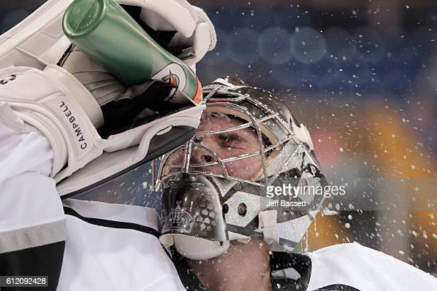 Goaltender Jack Campbell of the Los Angeles Kings cools down with water in preseason action October 2, 2016 in Vernon, British Columbia, Canada.
