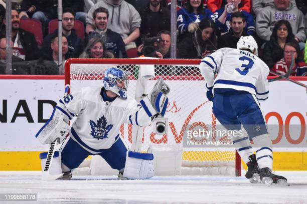 Goaltender Jack Campbell of the Toronto Maple Leafs gloves the puck during the first period against the Montreal Canadiens at the Bell Centre on...