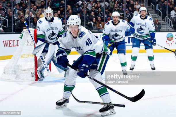 Goaltender Jacob Markstrom Elias Pettersson Alex Biega and Alexander Edler of the Vancouver Canucks look on during the first period of the game...