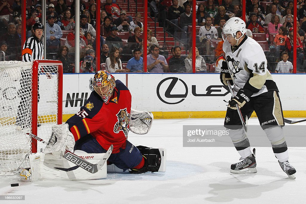 Goaltender Jacob Markstrom #35 of the Florida Panthers stops a shot by Chris Kunitz #14 of the Pittsburgh Penguins at the BB&T Center on April 13, 2013 in Sunrise, Florida.