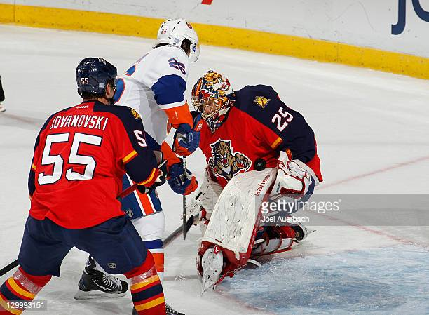Goaltender Jacob Markstrom of the Florida Panthers stops a third period shot by Matt Moulson of the New York Islanders on October 22 2011 at the...