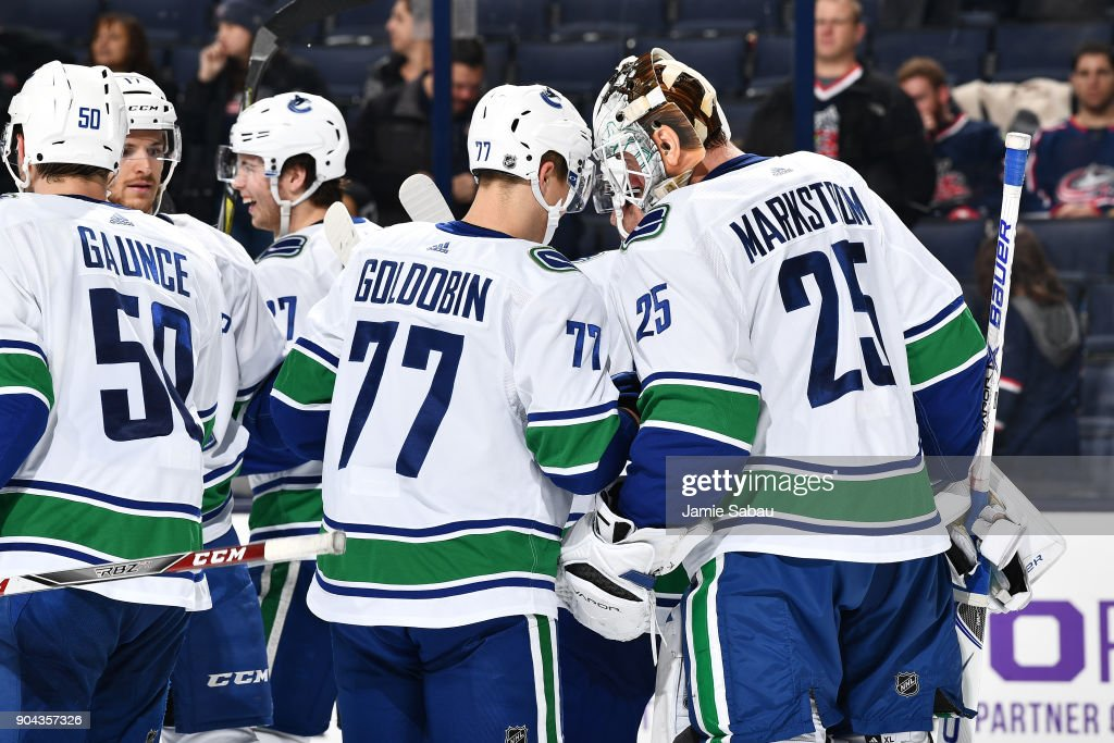 Goaltender Jacob Markstrom #25 of the Vancouver Canucks celebrates with teammate Nikolay Goldobin #77 of the Vancouver Canucks after defeating the Columbus Blue Jackets 5-2 in a game on January 12, 2018 at Nationwide Arena in Columbus, Ohio.