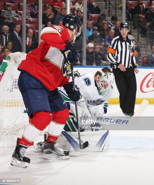 Goaltender Jacob Markstrom of the Vancouver Canucks covers the puck keeping Aleksander Barkov of the Florida Panthers from getting a rebound at the...