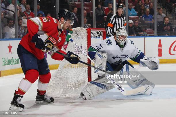 Goaltender Jacob Markstrom of the Vancouver Canucks defends the post against a tip in attempt by Aleksander Barkov of the Florida Panthers at the BBT...