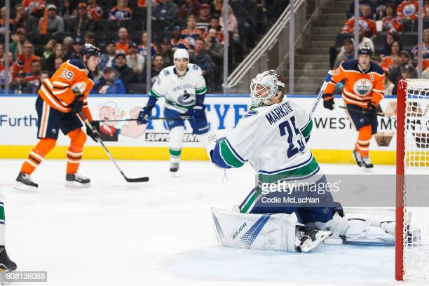 Goaltender Jacob Markstrom of the Vancouver Canucks looks for the puck while playing against the Edmonton Oilers at Rogers Place on January 20 2018...