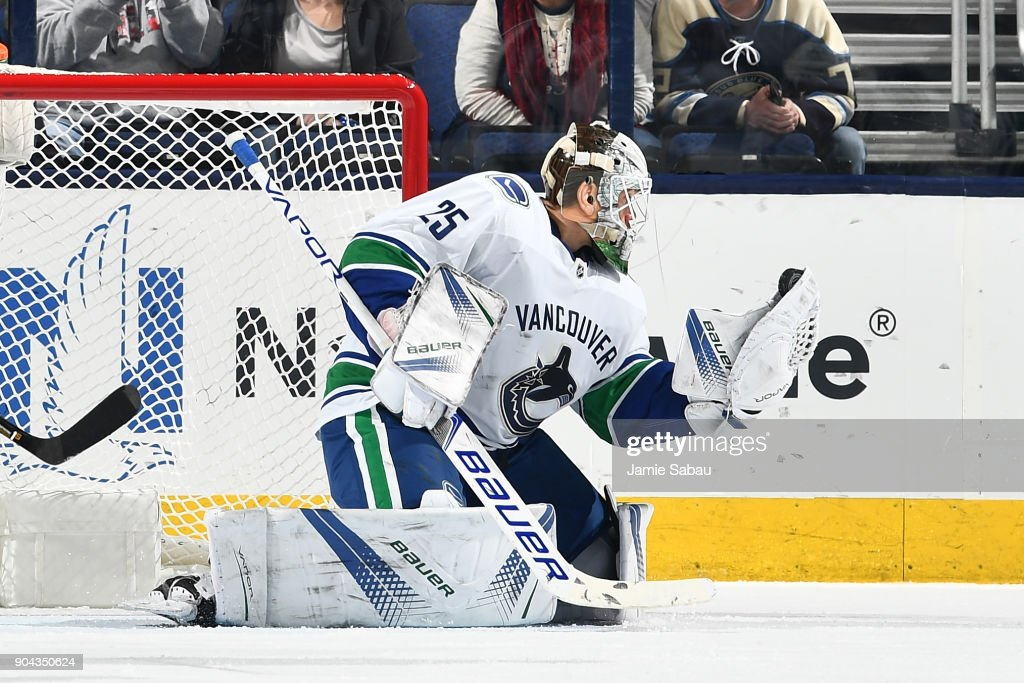 Goaltender Jacob Markstrom #25 of the Vancouver Canucks makes a glove save during the second period of a game against the Columbus Blue Jackets on January 12, 2018 at Nationwide Arena in Columbus, Ohio.
