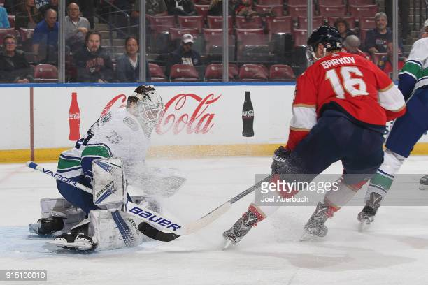 Goaltender Jacob Markstrom of the Vancouver Canucks stops a shot by Aleksander Barkov of the Florida Panthers during first period action at the BBT...