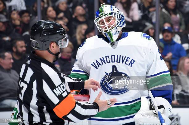 Goaltender Jacob Markstrom of the Vancouver Canucks talks with referee Dan O'Halloran during the third period of the game against the Los Angeles...