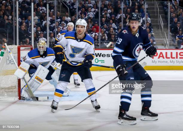 Goaltender Jake Allen Brayden Schenn of the St Louis Blues and Patrik Laine of the Winnipeg Jets keep an eye on the play during second period action...
