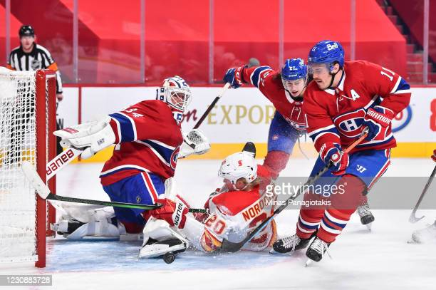 Goaltender Jake Allen of the Montreal Canadiens makes a skate save as teammates Alexander Romanov and Brendan Gallagher defend against Joakim...