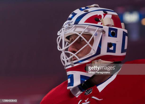 Goaltender Jake Allen of the Montreal Canadiens skates during the warm-up prior to the home opening game against the Calgary Flames at the Bell...