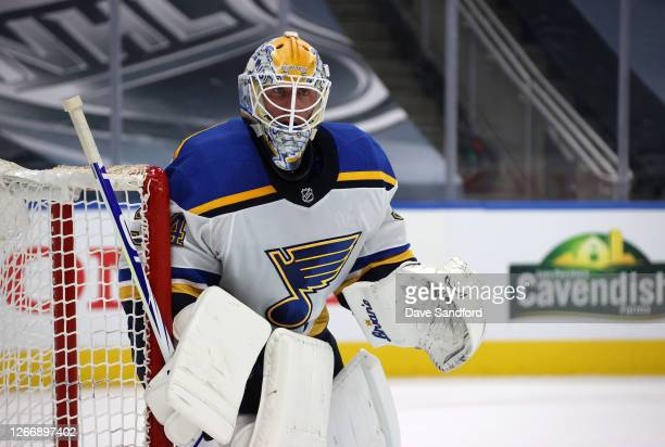 Goaltender Jake Allen of the St. Louis Blues defends his net in the third period of Game Four of the Western Conference First Round of the 2020 NHL...
