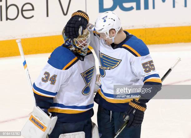 Goaltender Jake Allen of the St Louis Blues gets congratulated by teammate Colton Parayko after backstopping the Blues to a 52 victory over the...