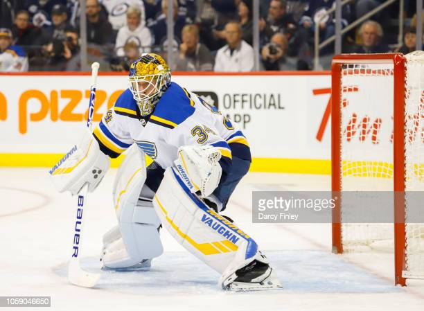 Goaltender Jake Allen of the St Louis Blues guards the net during first period action against the Winnipeg Jets at the Bell MTS Place on October 22...