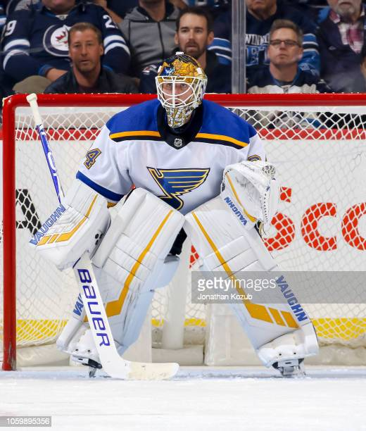 Goaltender Jake Allen of the St Louis Blues guards the net during third period action against the Winnipeg Jets at the Bell MTS Place on October 22...