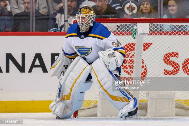 Goaltender Jake Allen of the St Louis Blues guards the net during first period action against the Winnipeg Jets at the Bell MTS Place on December 7...