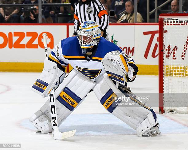 Goaltender Jake Allen of the St Louis Blues guards the net during third period action against the Winnipeg Jets at the MTS Centre on December 15 2015...