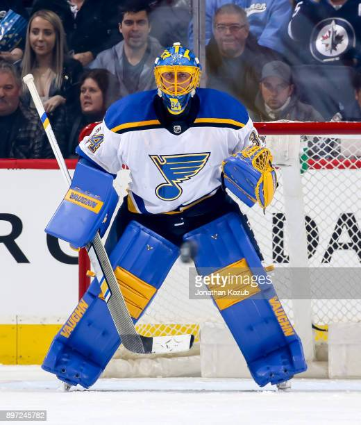 Goaltender Jake Allen of the St Louis Blues guards the net during first period action against the Winnipeg Jets at the Bell MTS Place on December 17...